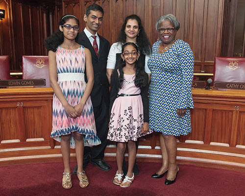photo of Senator Moore and and the Gosukonda family.